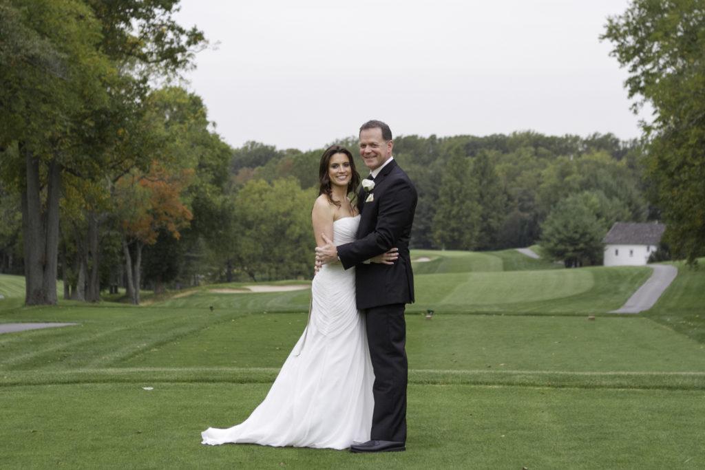 Deerfield CC wedding - bride and groom on tee box