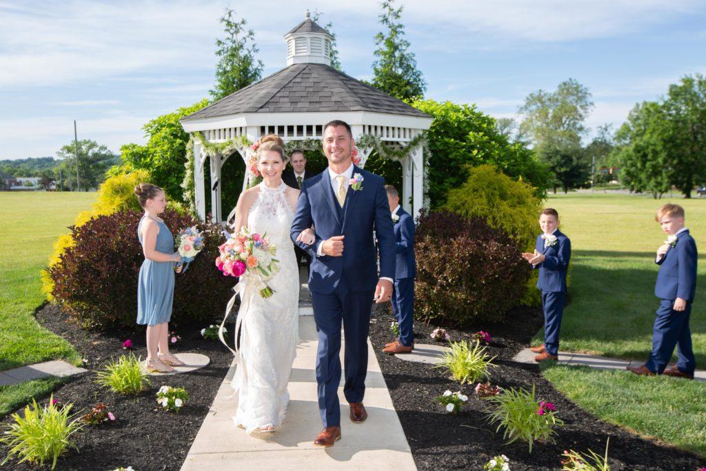 Outdoor wedding - gazebo - bride and groom