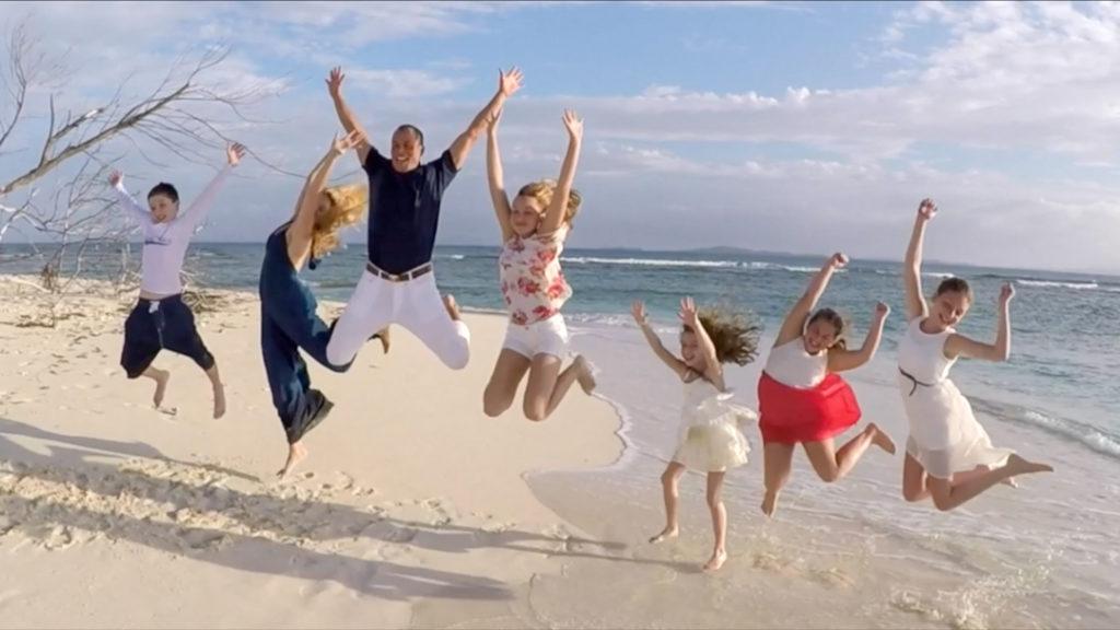 beach wedding beach family jumping fun