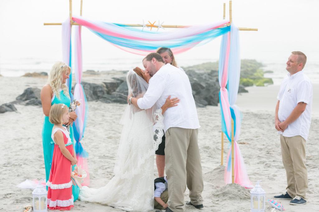 beach wedding kiss sand