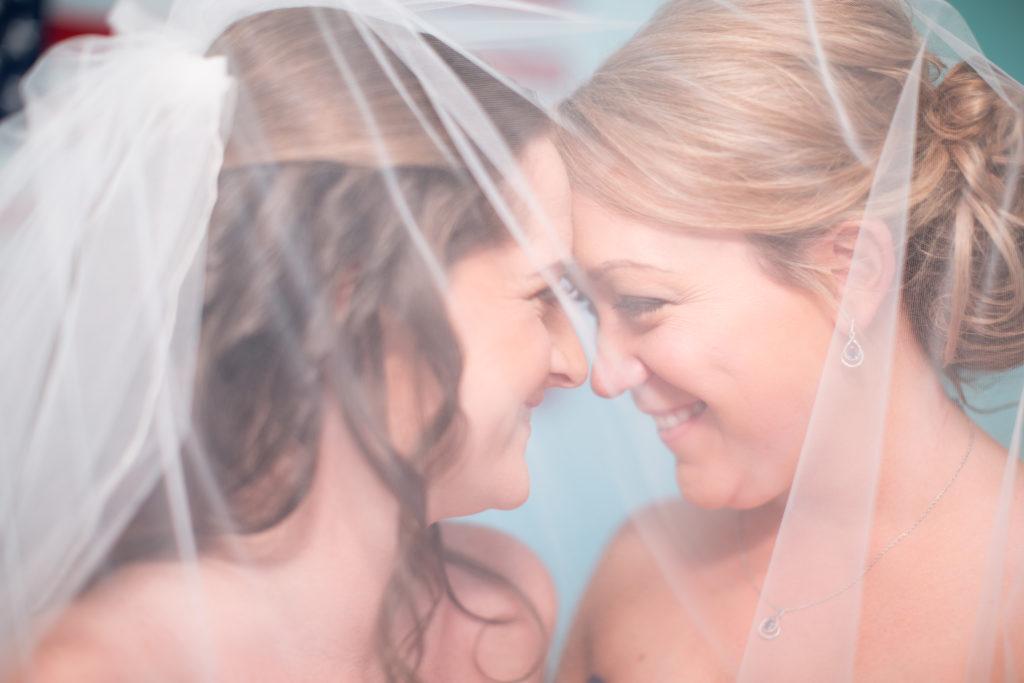 bridesmaids under veil